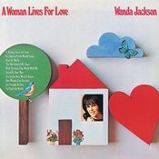 A Woman Lives For Love Songs